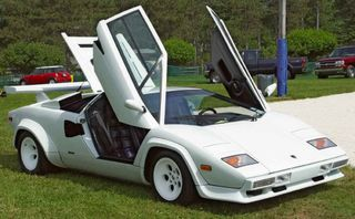 1985-Lamborghini-Countach-White-Front-Angle-Open-Doors-st