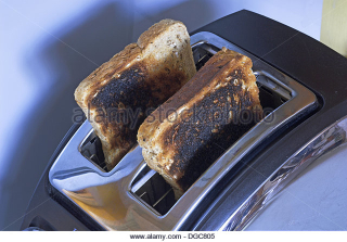 Burnt-toast-in-toaster-burned-dgc805